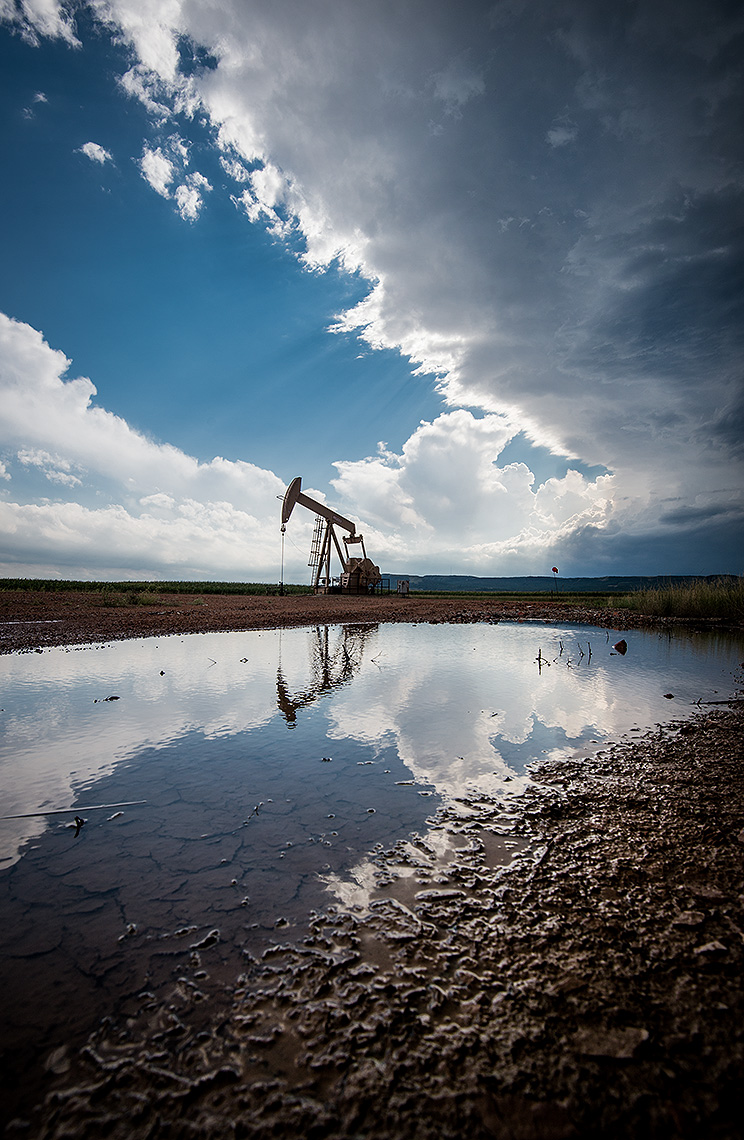 Oil Well Pump Reflection with Clouds