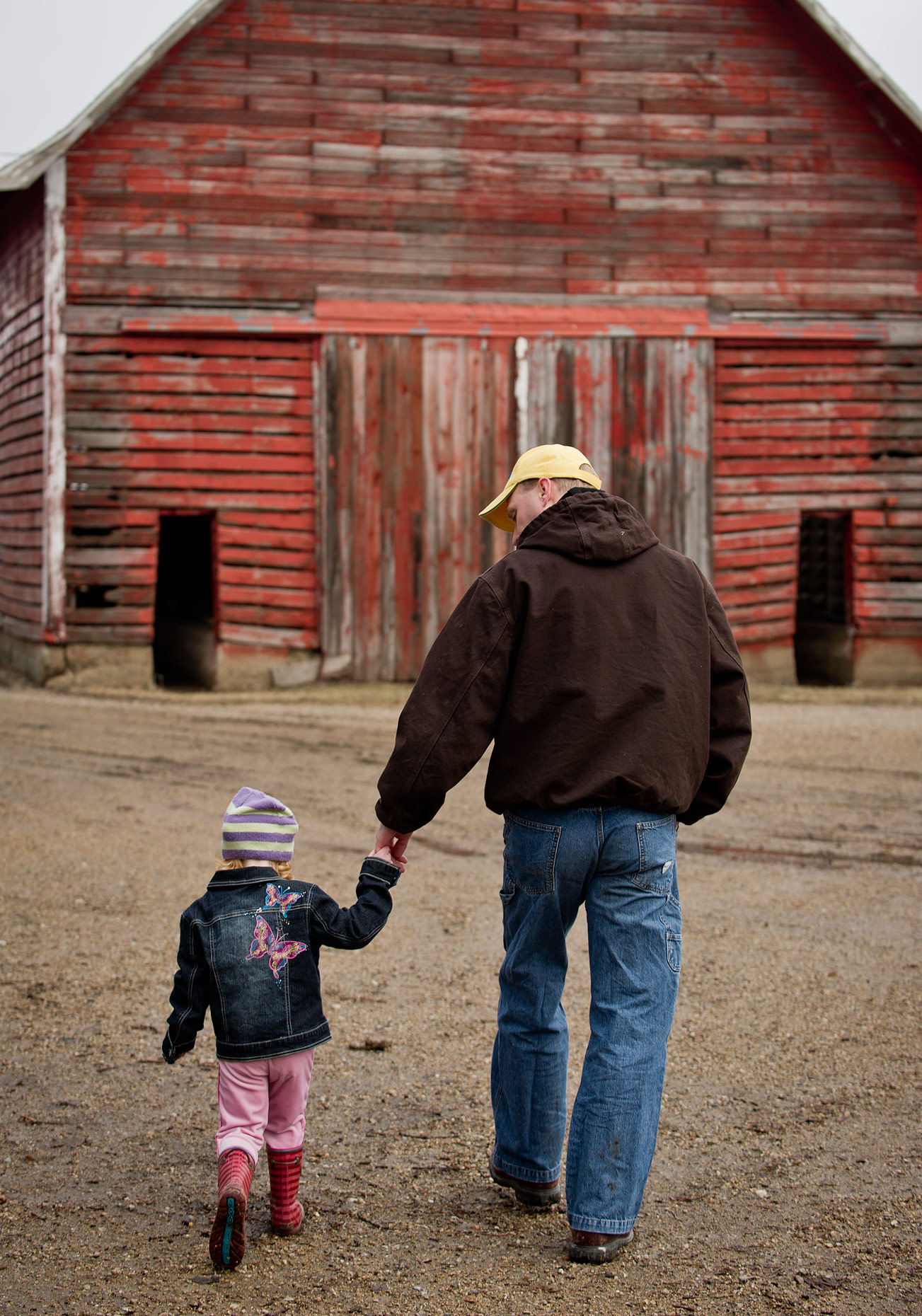 Father and Daughter Walking on the Farm Photograph