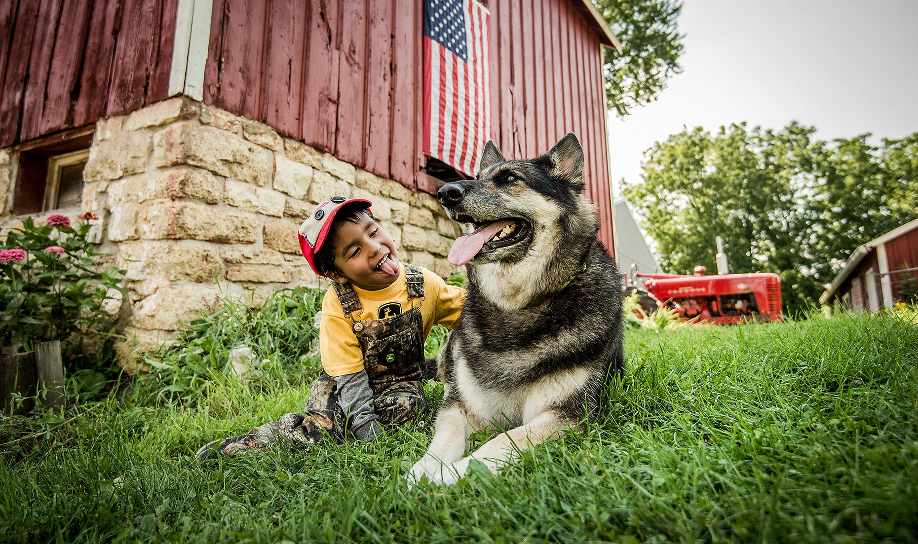 Boy with Dog on Farm