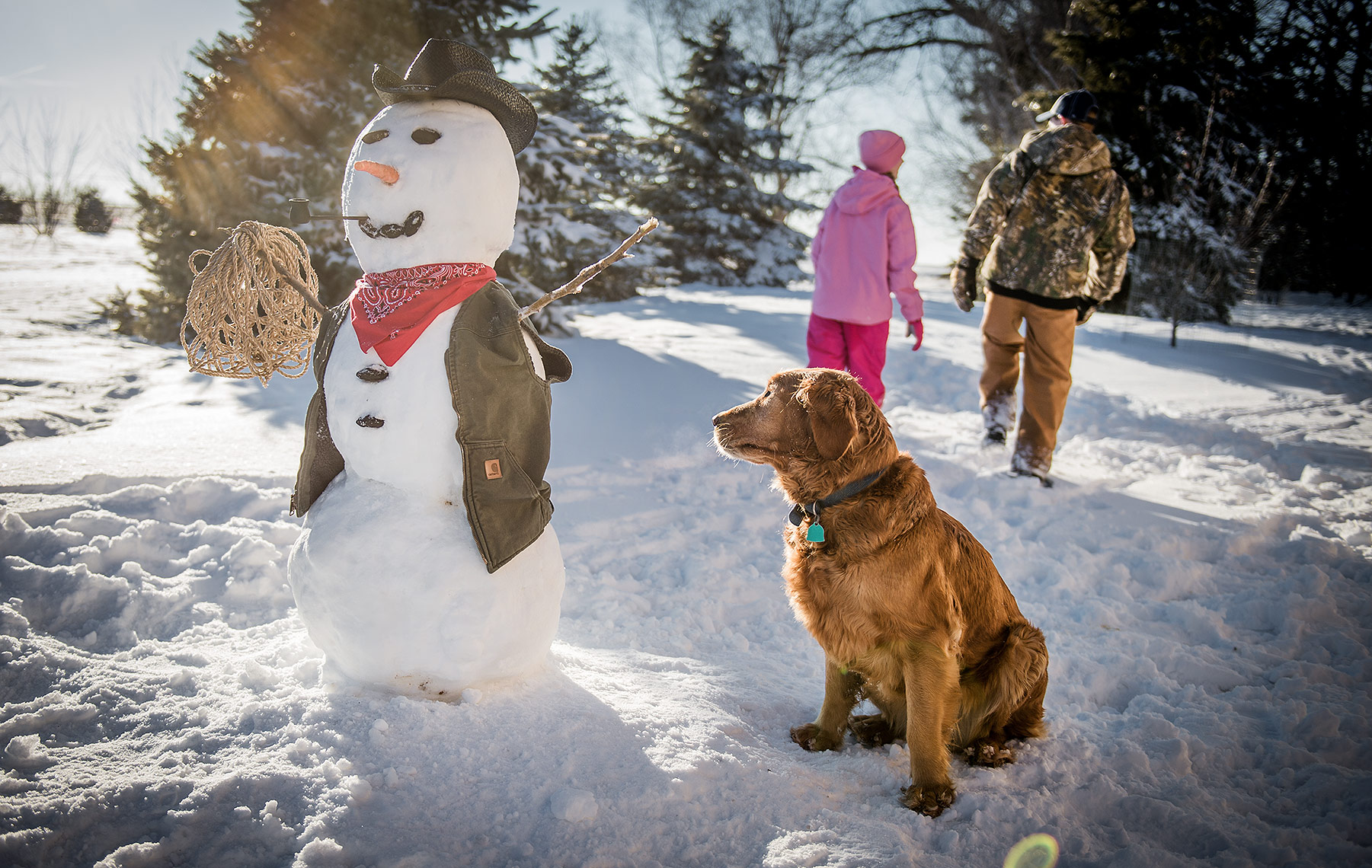 Dog and Snowman in Winter