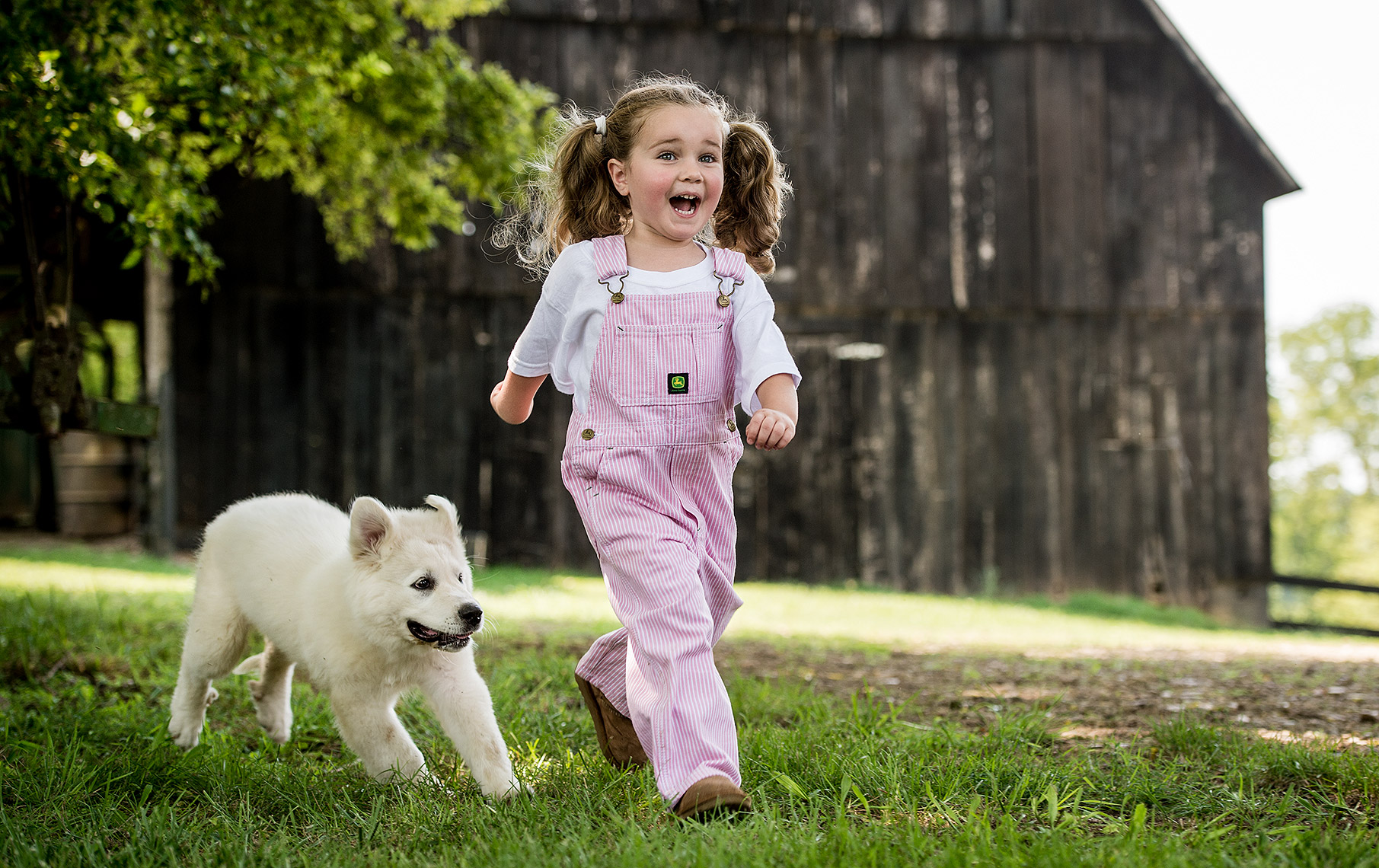 Young Girl with White Dog