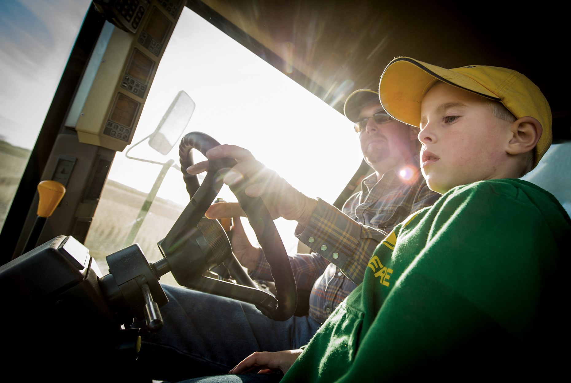 Farmer and Son in Combine