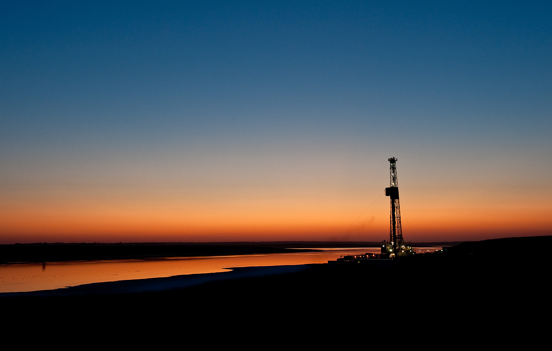 Oil Rig at Sunset Photograph