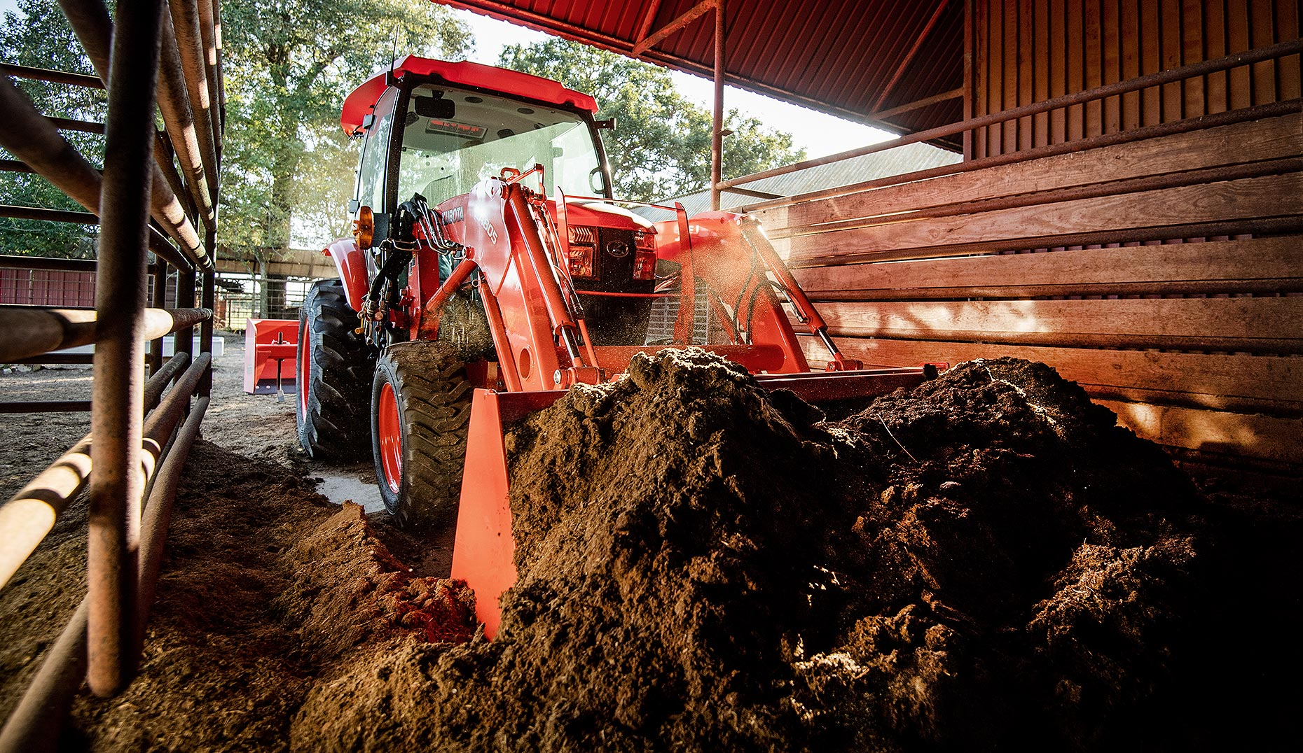 Tractor Scooping Manure in Barn
