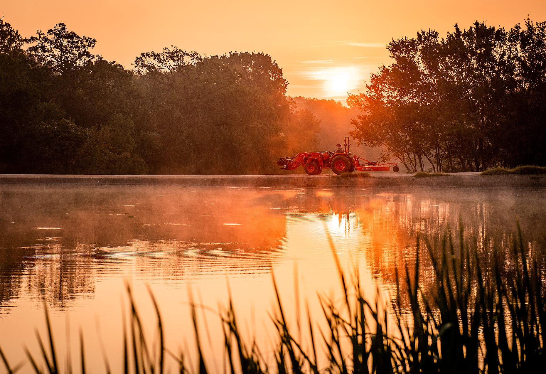 Tractor and Farm Pond at Sunrise