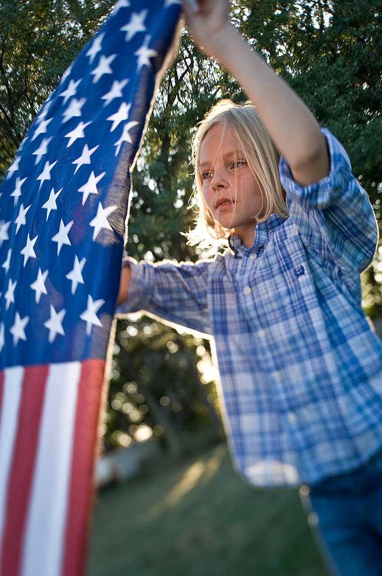 Young Girl and American Flag Photograph
