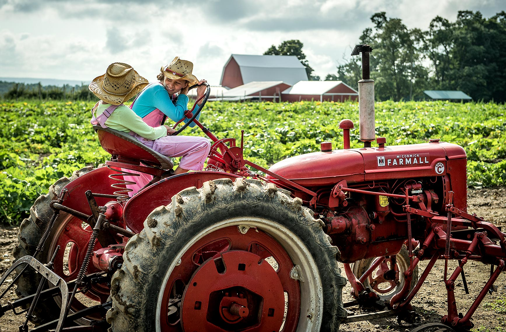 Twin Girls on Tractor